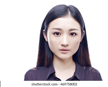 passport photo of a young and beautiful asian girl, isolated on white background.