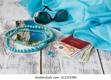 passport, photos, banknote money on wooden table for use as traveling concept