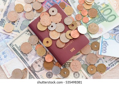 Passport and several country banknotes and coins