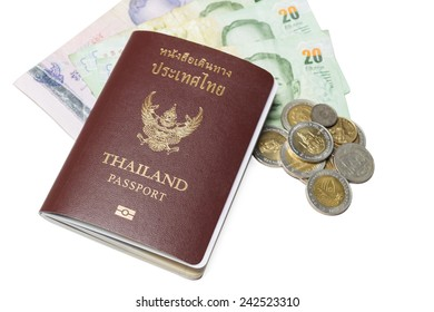 Passport of thai and money isolated on white background.