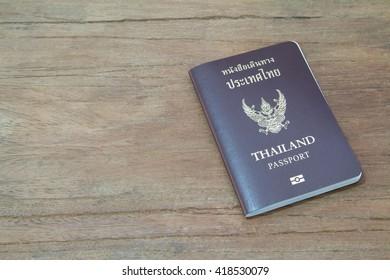 Passport Thailand on wooden background