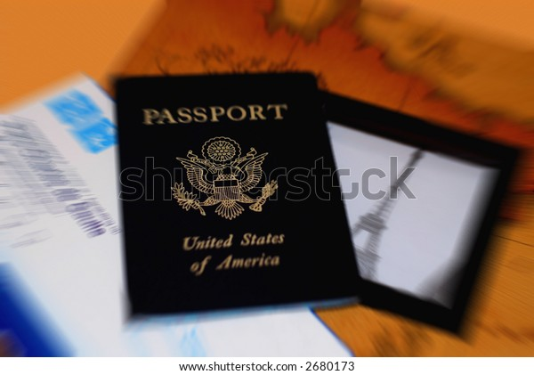 Passport and ticket to Paris with motion blur centered on eagle.