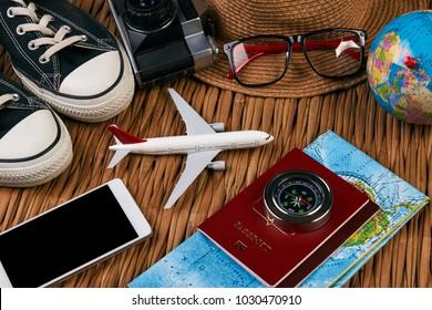 Passport travel document photo camera sunglasses globe map, top view. Summer vacation, travel, tourism and objects concept. Traveler items vacation travel accessories holiday long weekend day concept.