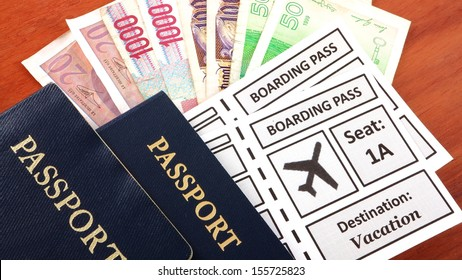 Passports with airline boarding pass and foreign currency