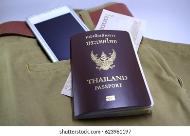 Passports, banknotes and smartphones Put on brown pants Prepare to travel