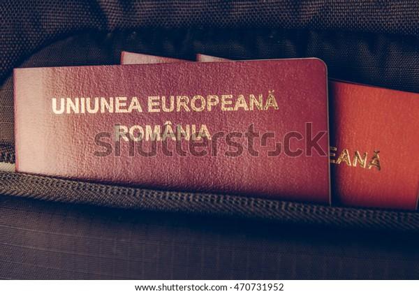 Passports in black travel bag.