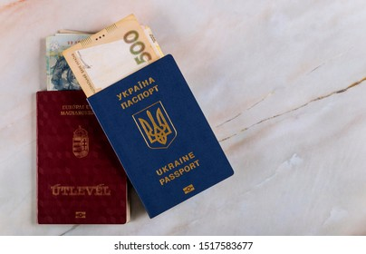 Passports of dual citizens Ukraine and Hungarian passport for traveling Concept on the Ukrainian and Hungarian money forint hryvnia national currency