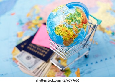 Passports, money, tickets, globe and map of the world as a vacation concept. Summer journey preparation. Planning holidays, checking documents, choosing destination point, having fun.