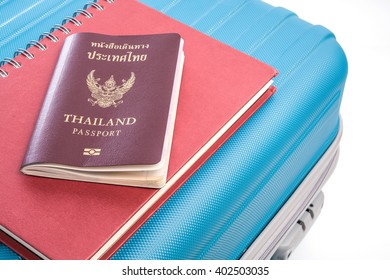 passports on blue travel bag view close up