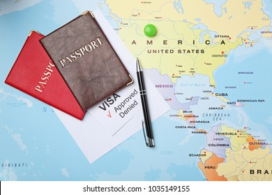 Passports and pen on map. Approved American visa