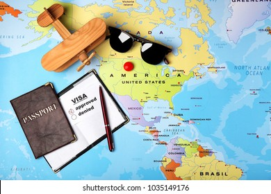 Passports, sunglasses and toy airplane on map. Approved American visa