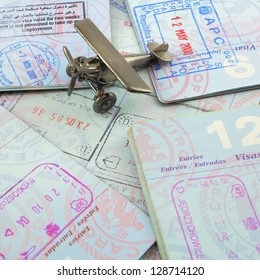 Passports and toy airplane