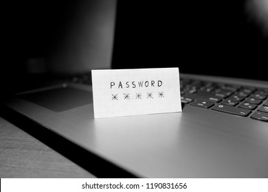 Password concept on sheet, laptop background