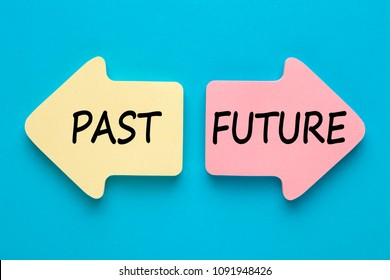 Past and Future written in paper arrows on blue background.