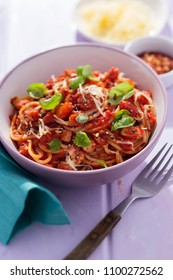 Pasta all'amatriciana with basil and parmesan