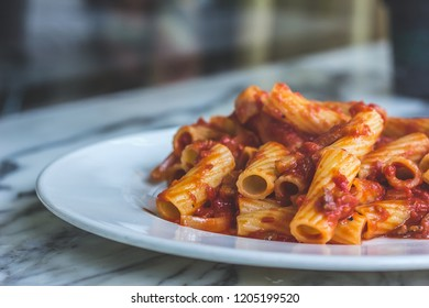 Pasta with amatriciana sauce made with guanciale, tomato and pepper