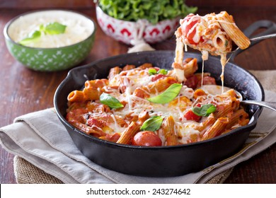 Pasta bake with whole wheat penne, tomatoes and mozarella