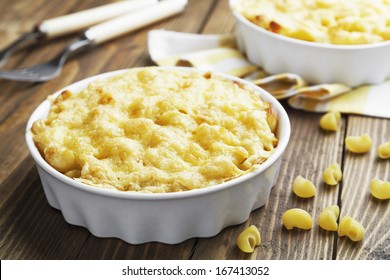 Pasta baked with cheese in a ceramic pot