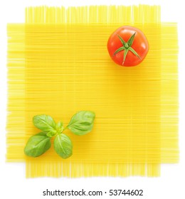 Pasta, basil and tomato isolated on white background