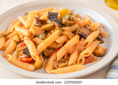Pasta caponata on a plate close up