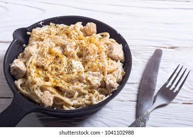 Pasta carbonara with cream sauce and chicken