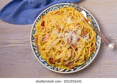 Pasta carbonara. Creamy Spaghetti Carbonara. Italian cuisine dish. View from above, top, horizontal