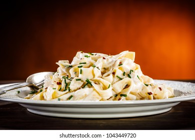 Pasta carbonara on wooden table