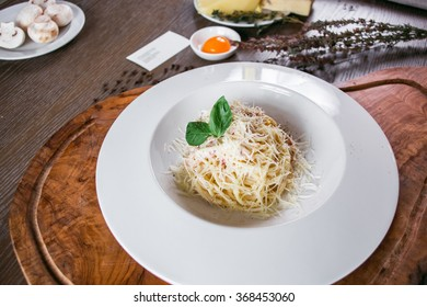 pasta carbonara on a wooden table