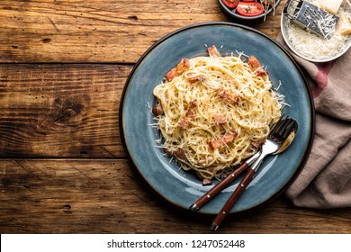 pasta carbonara, spaghetti, cooked according to the traditional Italian recipe pasta alla carbonara with egg sauce and fried pancetta