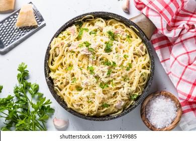 Pasta carbonara, traditional italian pasta spaghetti with bacon and cream sauce. Top view.