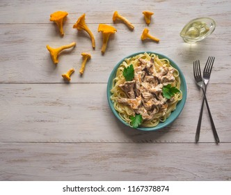 Pasta with chanterelle mushroom sauce. The view from the top. Rustic dishes.