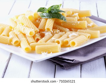 Pasta with cheese over a white plate, horizontal image