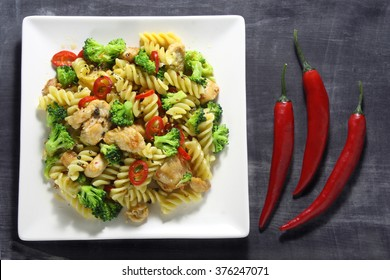 Pasta with chicken, broccoli and hot paprika