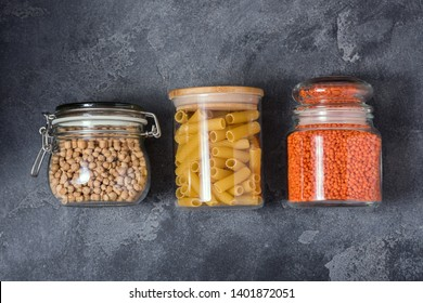 Pasta, chickpeas, lentils in glass jars, eco-friendly lifestyle and shopping, zero waste and plasticfree storage, sustainable living concept