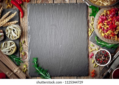 Pasta in a composition with vegetables and kitchen accessories