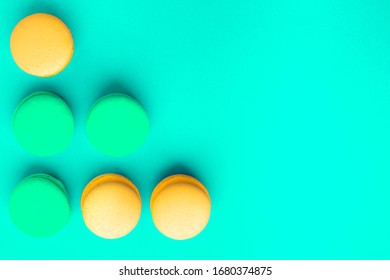 pasta cookies in the lower left corner on a mint background, place for text