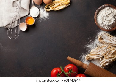 Pasta cooking ingredients on kitchen table. Top view with space for your text