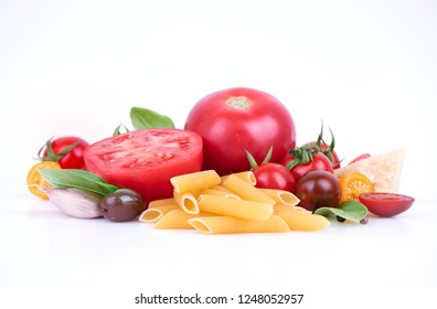 Pasta cooking set. Fresh ingredients for simple pasta recipe with tomatoes and olives.
