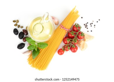 Pasta cooking set. Fresh ingredients for simple pasta recipe with tomatoes and olives. White background