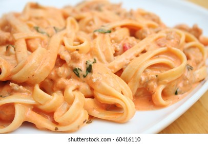 Pasta with Creamy Homemade Tomato Sauce with Basil and Italian Sausage