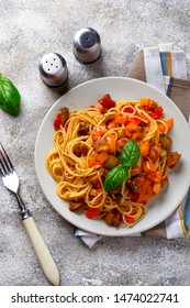 Pasta with eggplant, bell pepper and tomatoes. Vegan dish