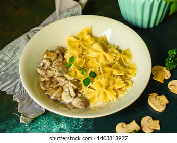 pasta farfalle with julienne mushrooms (fresh dish). food background. top