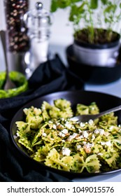 pasta farfalle with parsley, brynza and walnuts