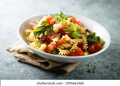 Pasta fresh tomato salad with red onion