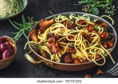 Pasta with freshly picked chanterelle mushrooms, capers, parmesan cheese and herbs