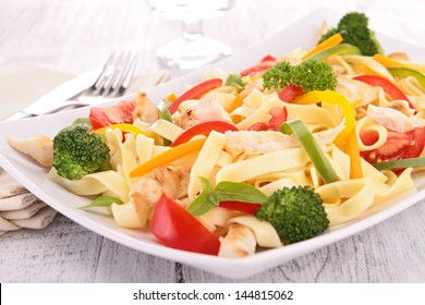 pasta with fried chicken and vegetables