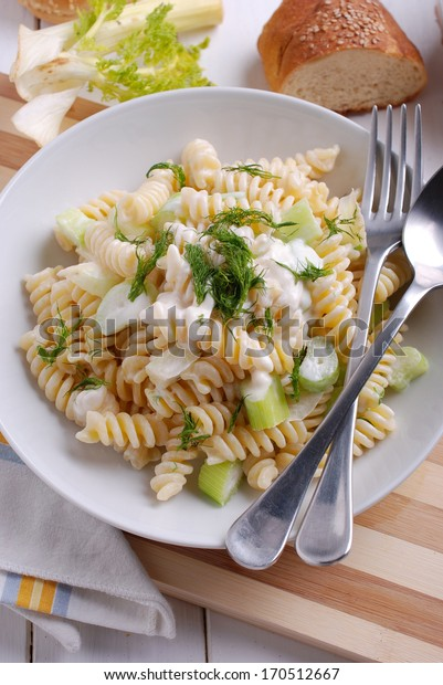 pasta with gorgonzola cheese and fennel on the white table