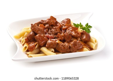 Pasta with goulash with parsley leaf, isolated on white background. Close-up