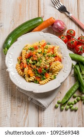 pasta with green peas zucchinis fresh tomatoes and carrot