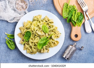 pasta with green sauce, pasta on white plate, stock photo